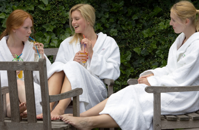 Women in robes at spa